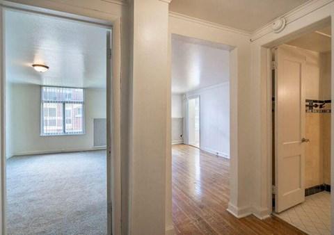hallway with open doors to rooms