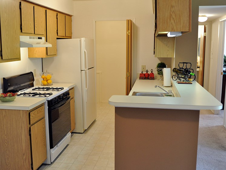 Well Equipped Kitchen at Bristol Square and Golden Gate Apartments, Wixom, MI, 48393