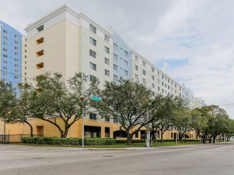 exterior building view with trees in front of Santa Clara I Apartments Miami, FL