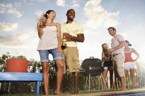Friends hanging together outside and grilling