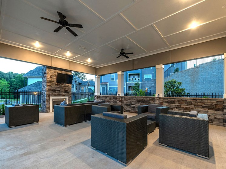 Outdoor Lounge Area with Flat Screen TVs, Chairs, Ceiling Fans and Entertainment Space at Asheville Exchange Apartment Homes, Asheville, NC 28806