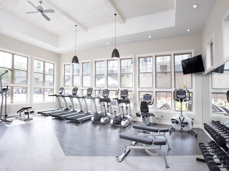 State of the Art Fitness Facility with Large Picture Windows, Various Cardio Machines, Free Weights and Flat Screen TVs at Asheville Exchange Apartment Homes, Asheville, NC 28806