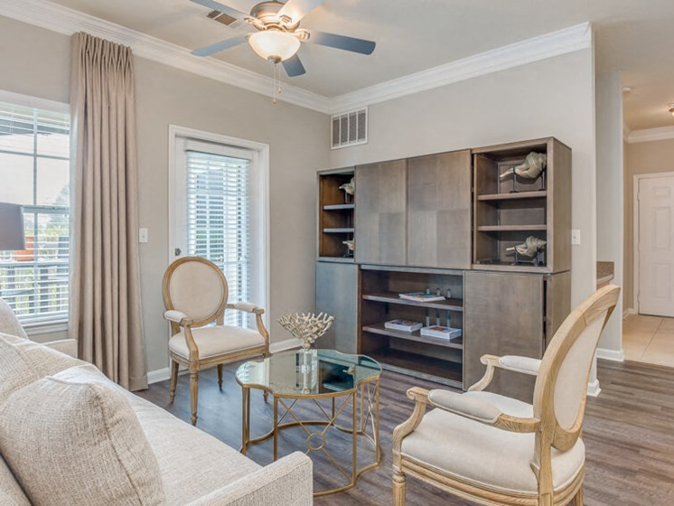 Gorgeous Modern Living Room with Elegant Crown Moulding and Wood Plank Vinyl Flooring (in Select Units) at Reserve Bartram Springs, Jacksonville, FL, 32258