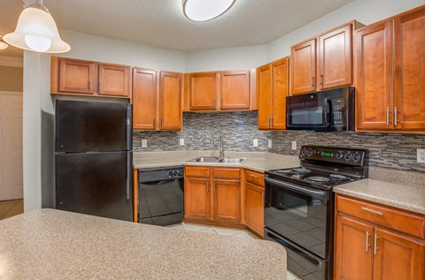 Gourmet Kitchens with G.E. Black Appliances and Maple Raised-Panel Cabinetry at Legends at Reserve Bartram Springs, Jacksonville, FL, 32258