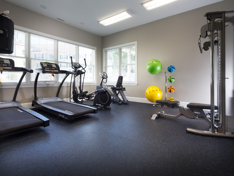 Treadmills and yoga balls inside fitness center at Abbott Landing apartments in Andover 01810