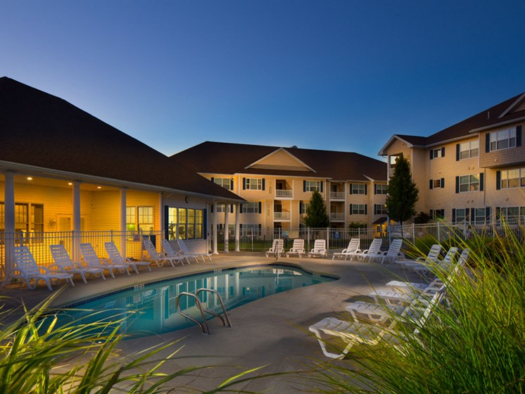 Night shot of swimming pool and sundeck area at Abbott Landing apartments 01810