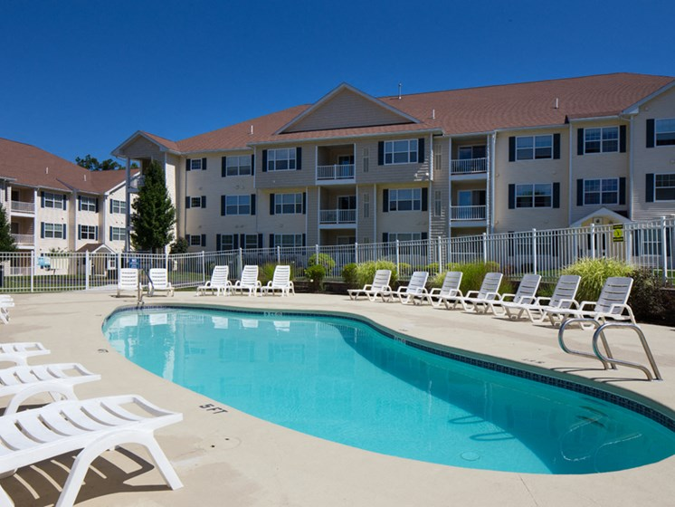 Swimming pool with large sundeck area at Abbott Landing apartments in Andover, MA