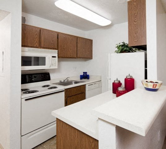 Kitchen & Breakfast Bar at Casa Bella Apartments in Tucson, AZ