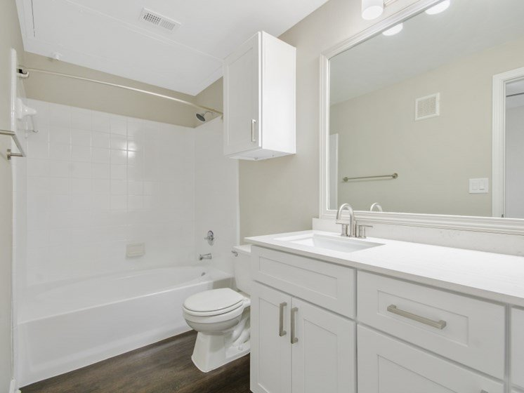 updated bathroom, white cabinets