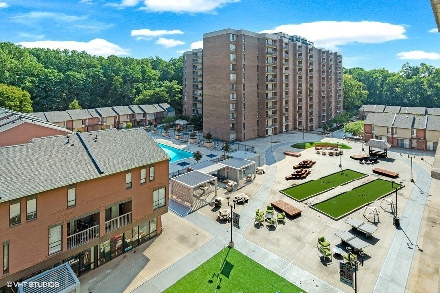 New Plaza with Fire Pit, Outdoor Games, Hammocks, Grills and More at Trillium Apartments in Fairfax