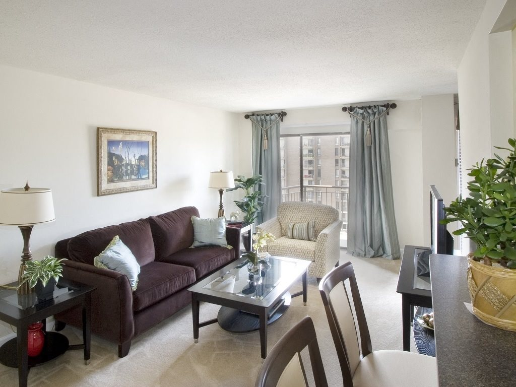 GOLD Spacious Living Area w/ Modern Furniture and Balcony Access at Trillium Apartments in Fairfax