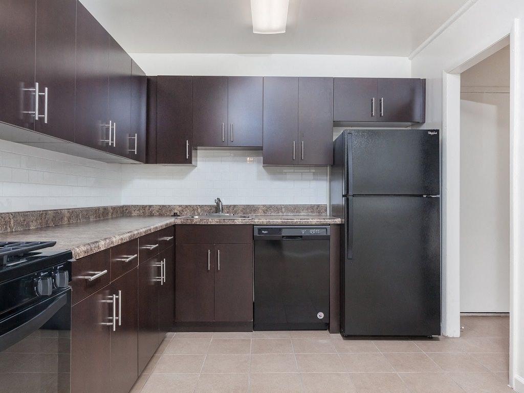 Newly renovated kitchen design with all black appliances at Circle Towers in Fairfax, VA