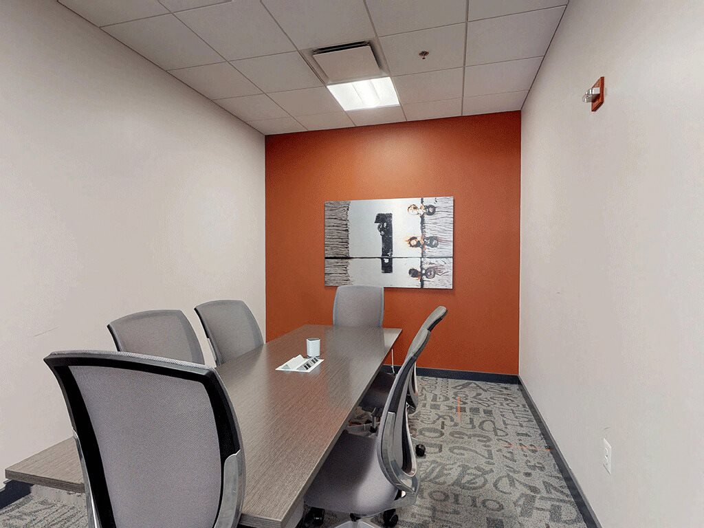 Conference room inside Our Business Center at Trillium Apartments in Fairfax, VA