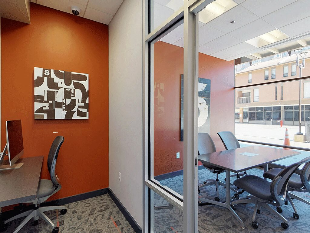 Conference Rooms w/ Individual Work Spaces in the Business Center at Trillium Apartments in Fairfax