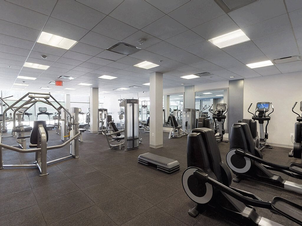 State-of-the-art Fitness Facility with Lots of Exercise Equipment at Trillium Apartments in Fairfax