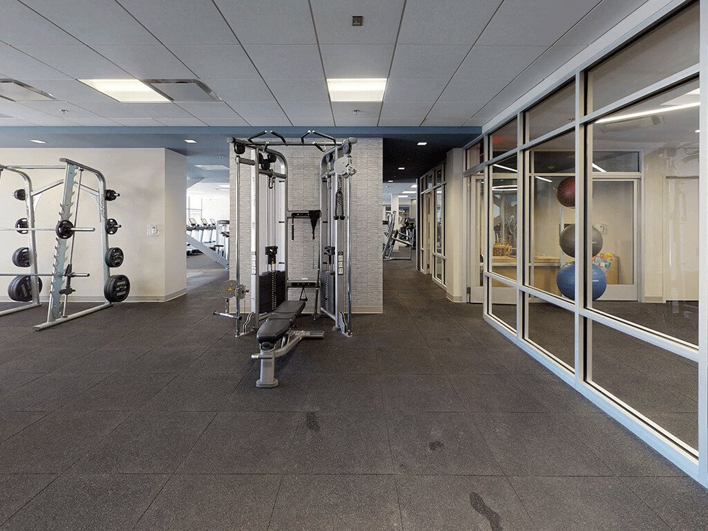 Large Fitness Center with Diverse Exercise Equipment at Trillium Apartments in Fairfax, VA