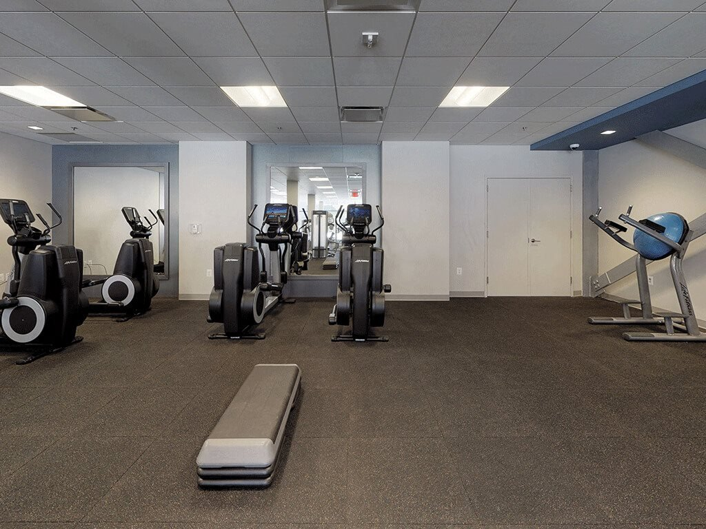 A Variety of Cardio Equipment in the Fitness Gym at Trillium Apartments in Fairfax, VA