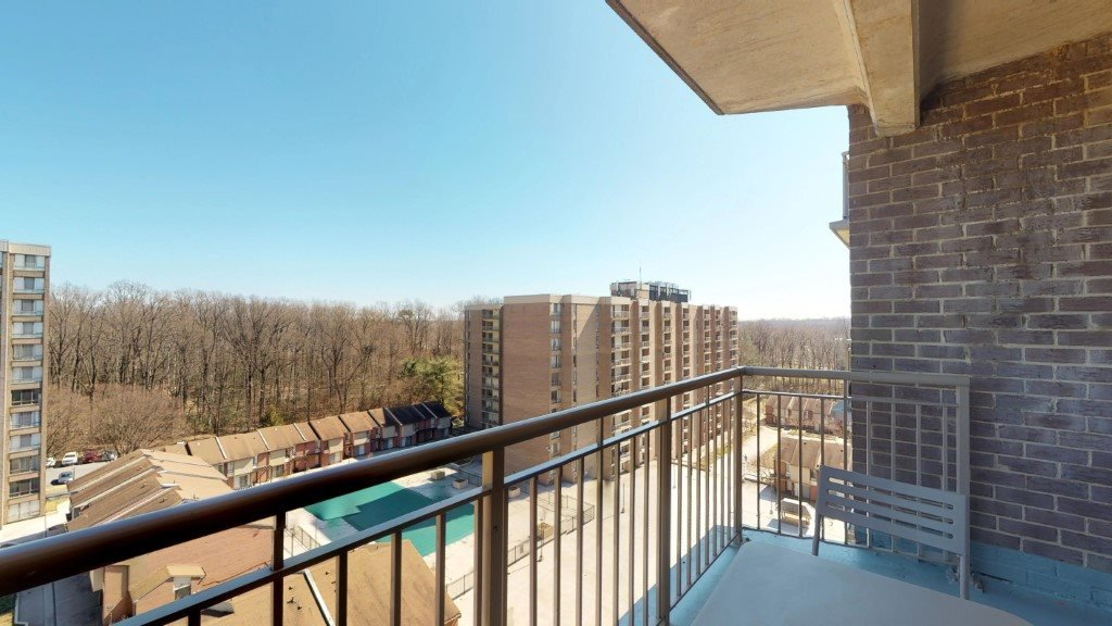 Spacious Balcony with Gorgeous Park Views at Trillium Apartments in Fairfax, VA