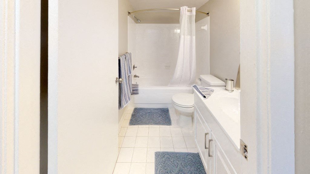 Sparkling White Bathroom Showing Bathtub, Toilet, and Sink at Trillium Apartments in Fairfax, VA