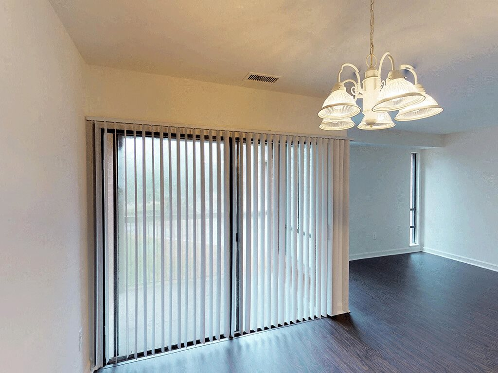 Bare Apartment Space with Large Windows and Blinds  at Trillium Apartments in Fairfax, VA