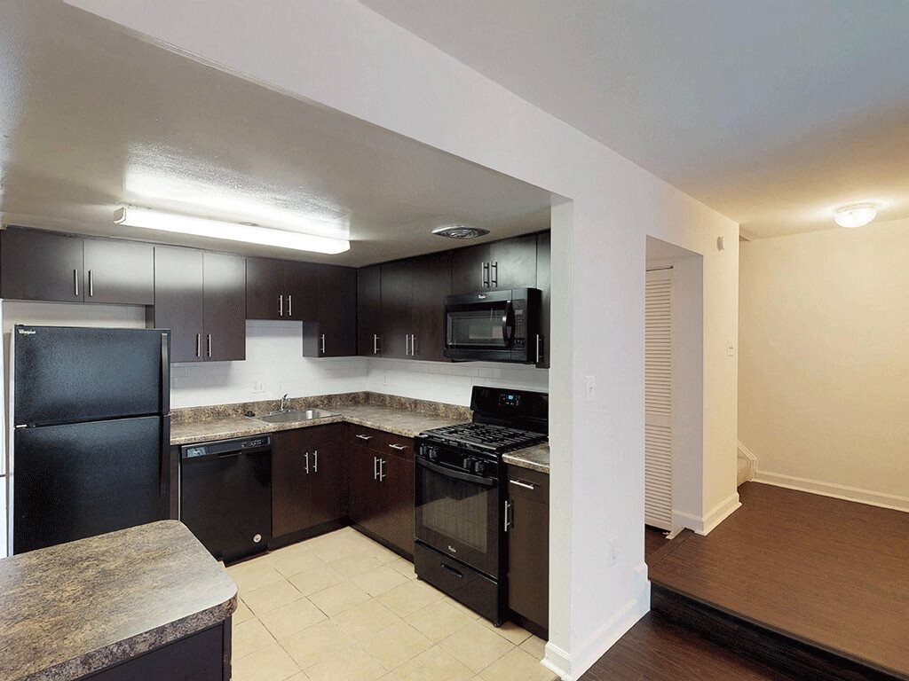 Open Kitchen with Upgraded Appliances at Trillium Apartments in Fairfax, VA