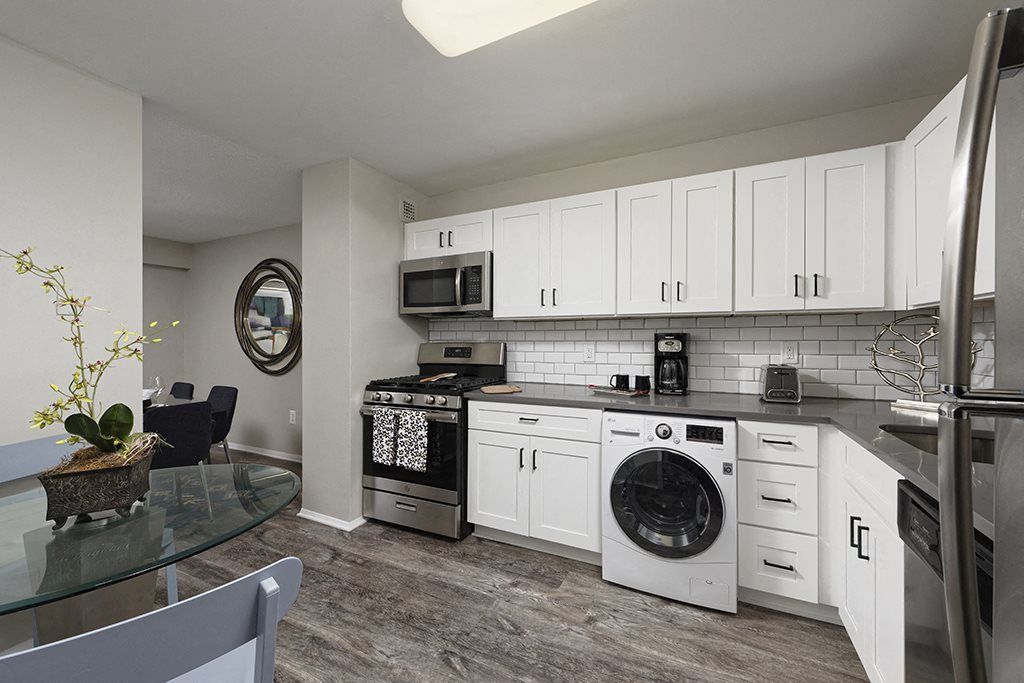 Modern kitchen with built-in laundry at Circle Towers in Fairfax, VA