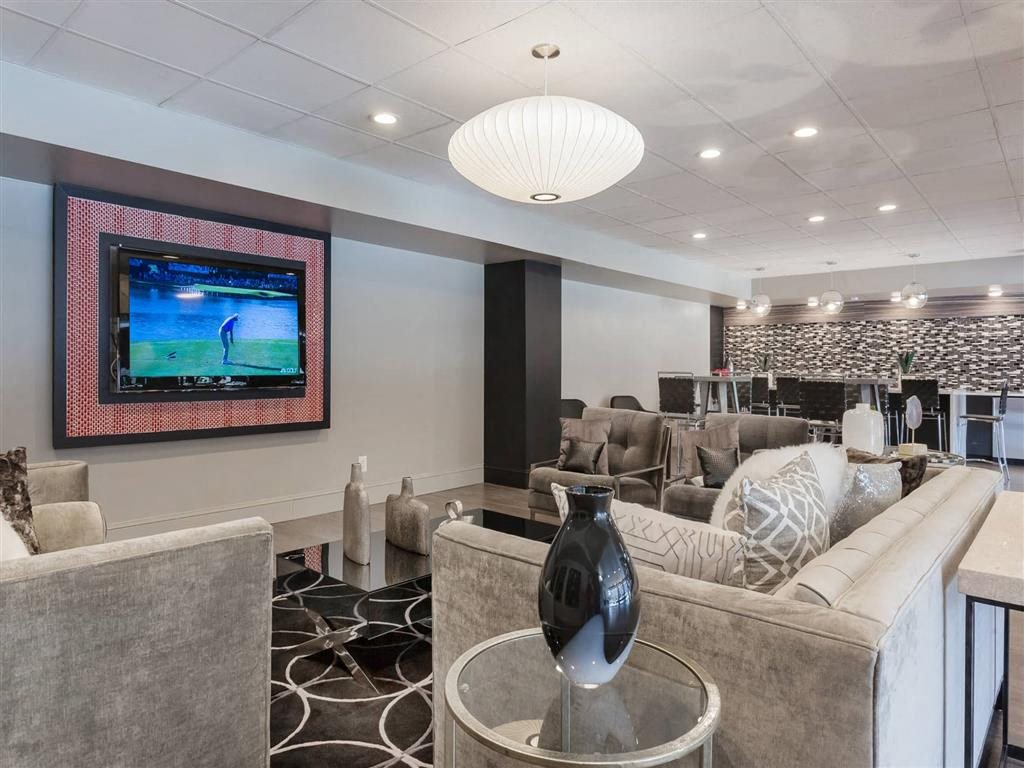 Relaxing Space in our Resident Lounge with Flat-Screen TV at Trillium Apartments in Fairfax, VA