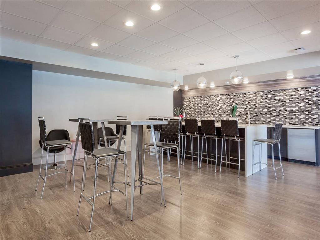 Gorgeous Kitchen and Dining Area in the Resident Lounge at Trillium Apartments in Fairfax, VA