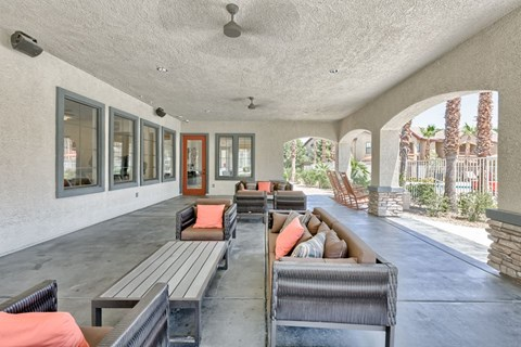 Covered Outdoor Common Living Room with Big Screen TV and Ceiling Fans