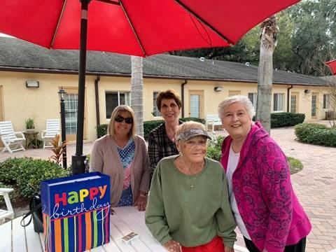 Seniors Enjoying In Outdoors at Savannah Court of Bartow, Bartow, FL, 33830