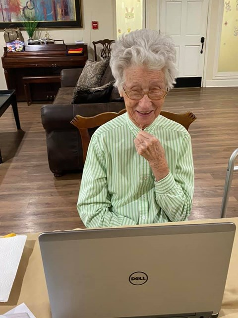 Senior Resident In-front Of Laptop at Savannah Court of Brandon, Brandon, Florida