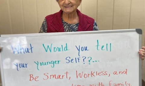Senior Resident Holding A Sign Board at Savannah Court of Camilla, Camilla, GA, 31730