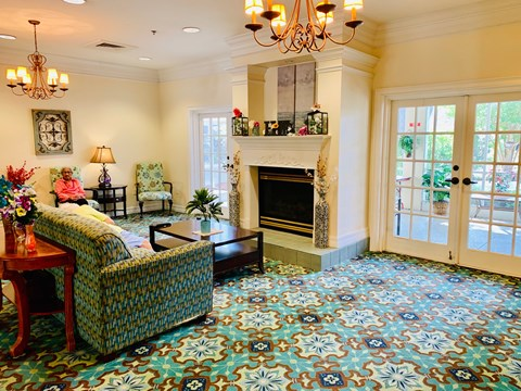 Front Day Room with Fireplace at Savannah Court of Haines City, Haines City