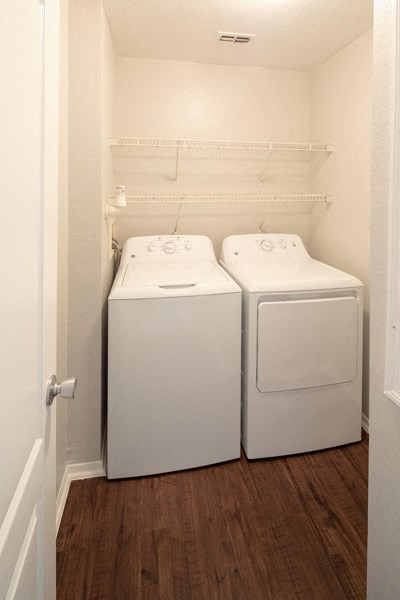Vacant apartment home full washer and dryer in laundry room