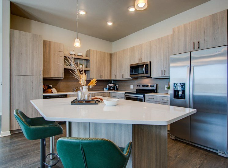Kitchen With Custom Maple Cabinetry at Rise at 2534, Colorado, 80534