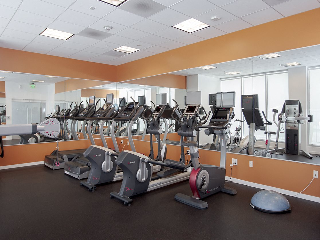 Koreatown, CA Apartments for Rent - The View Apartments Fitness Center with Mirrored Walls and Various Cardio Machines