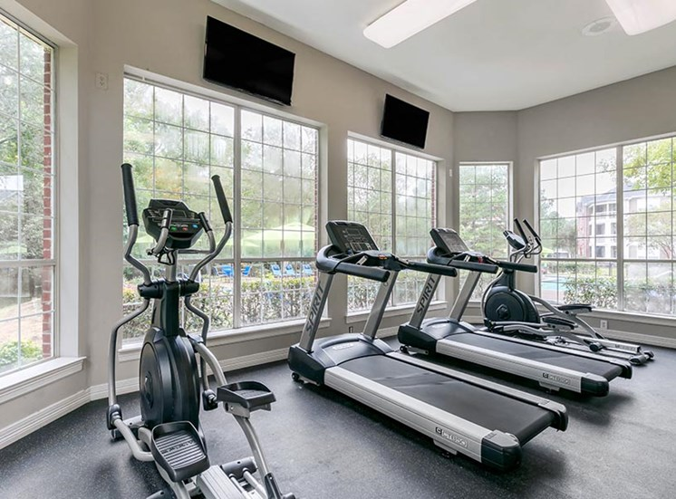 fitness center with treadmills and elliptical machine