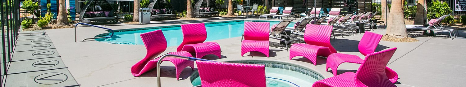 Villa Serena Apartments Pool and Spa Area Chairs Banner