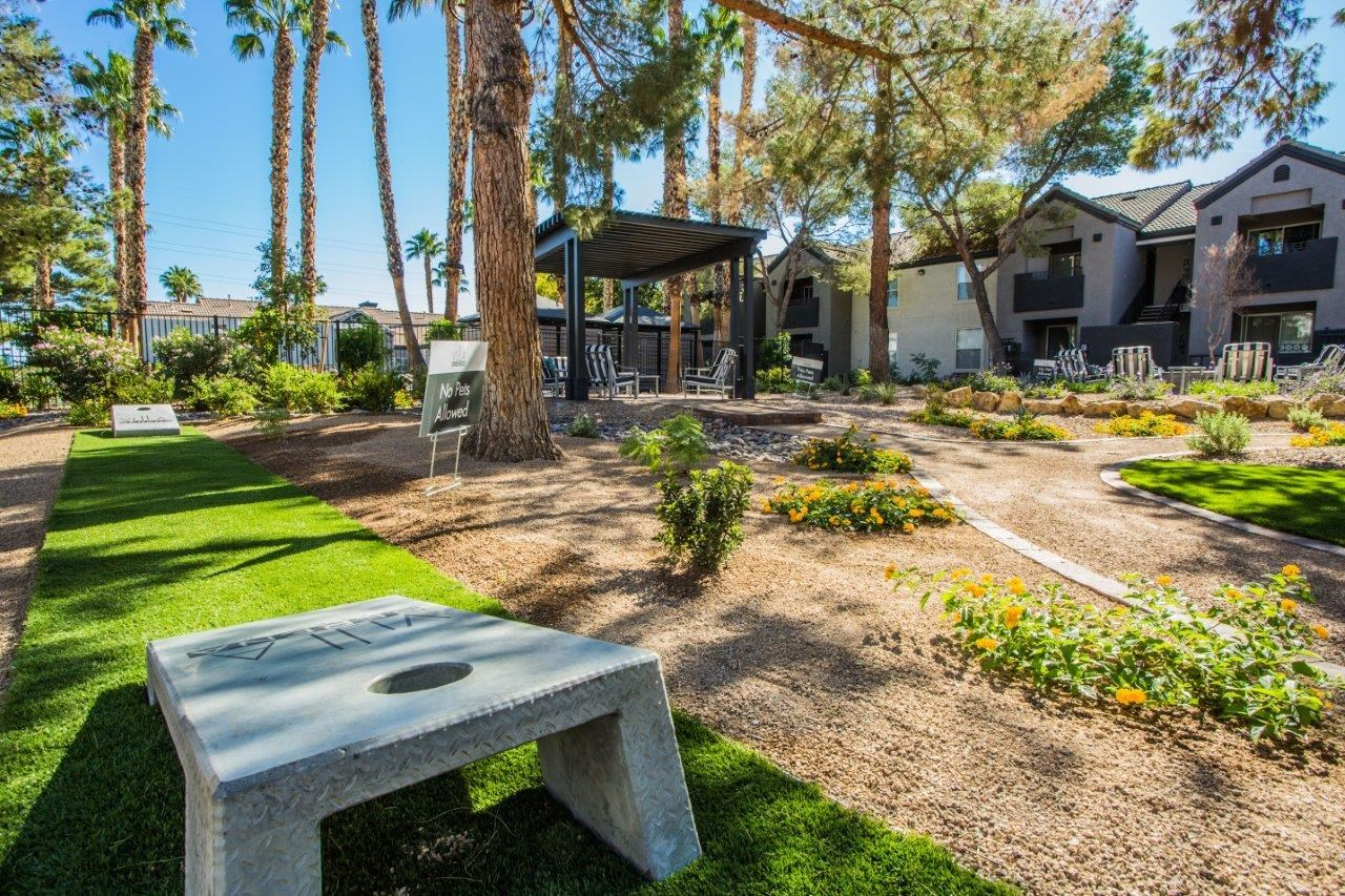 Villa Serena bag toss with trees and fire pit in the background