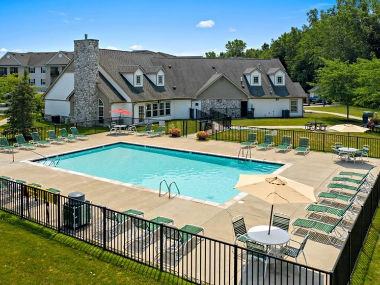 Resort Style Pool and Sundeck Area- Fairfield Apartments and Condominiums in Fenton, MI