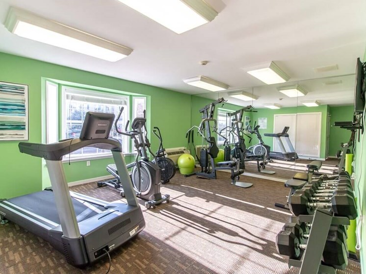 Fitness Center with Free Weights- Fairfield Apartments and Condominiums in Fenton, MI