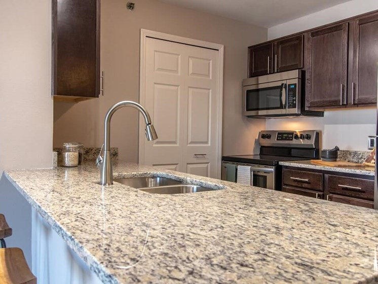 Granite Counter-tops in Updated Kitchens- Fairfield Apartments and Condominiums in Fenton, MI