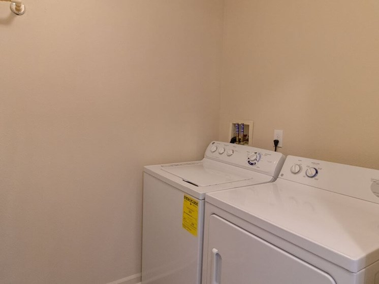 Full Size Washer and Dryer with Storage Area- Fairfield Apartments and Condominiums in Fenton, MI