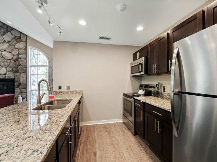 Clubhouse with Kitchen - Fairfield Apartments and Condominiums in Fenton, MI