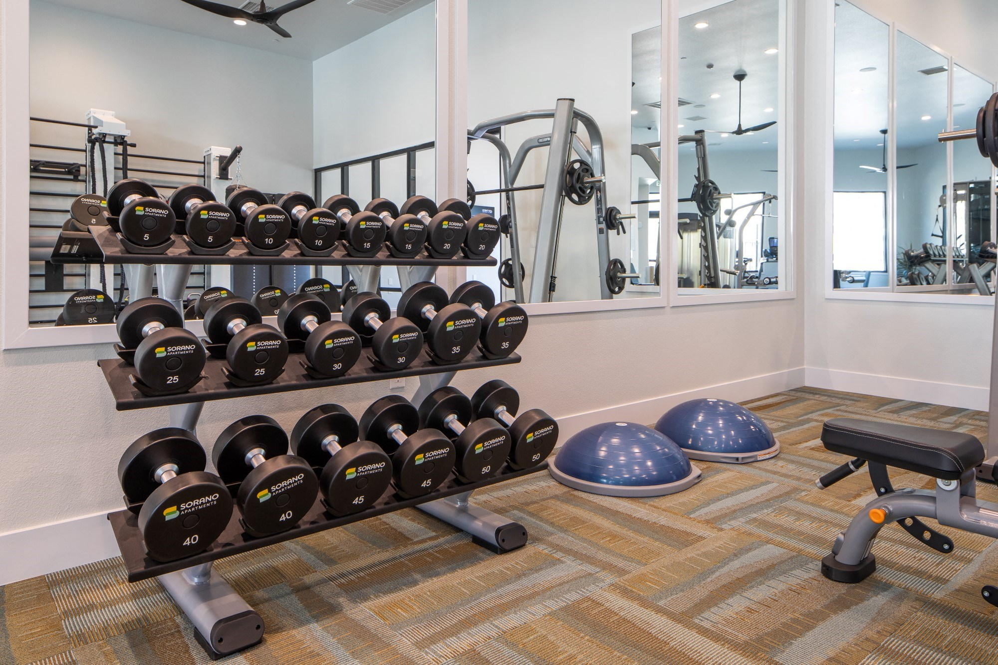 Sorano Apartments Fitness Center and Weight Rack