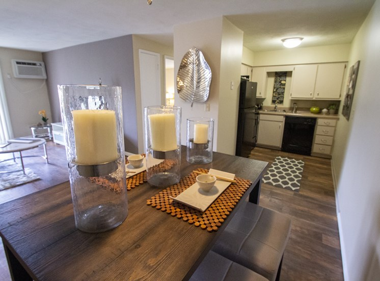 This is a photo of the dining area looking into the kitchen of a 560 square foot, 1 bedroom apartment at Aspen Village Apartments in Cincinnati, OH.