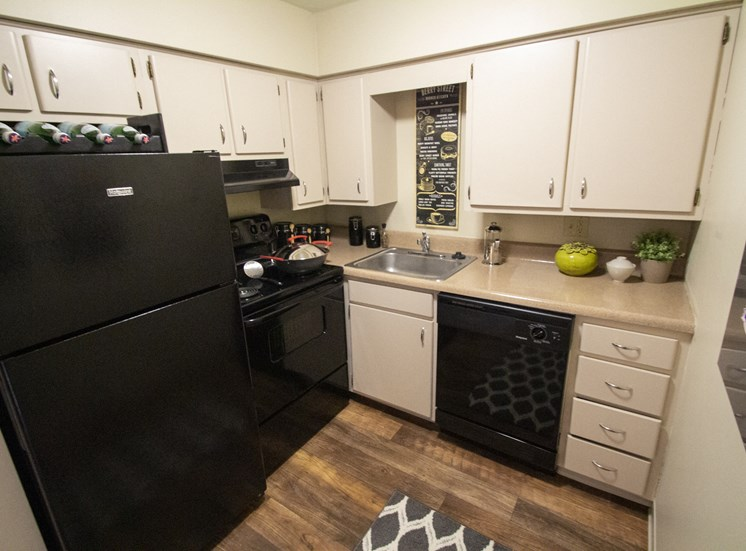 This is a photo of the kitchen of a 560 square foot, 1 bedroom apartment at Aspen Village Apartments in Cincinnati, OH.