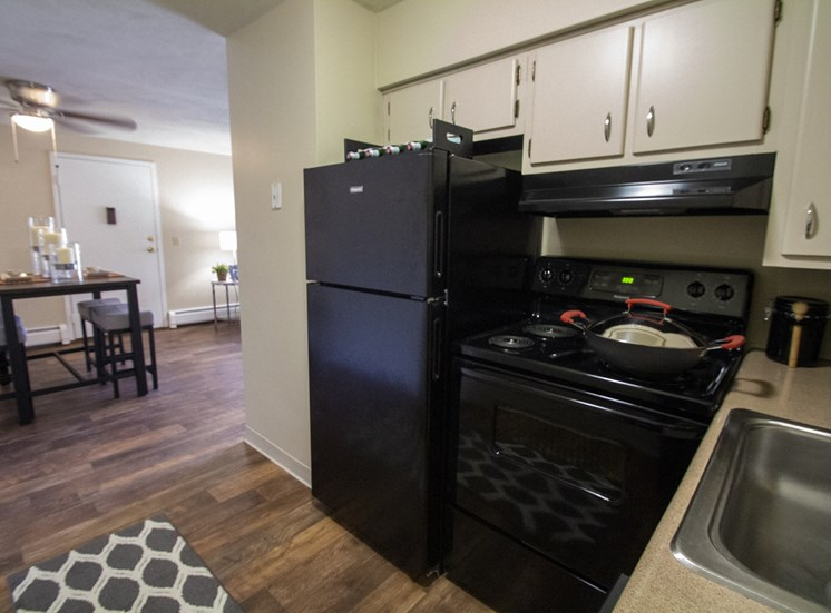 This is a photo of the kitchen looking into the dining area of a 560 square foot, 1 bedroom apartment at Aspen Village Apartments in Cincinnati, OH.