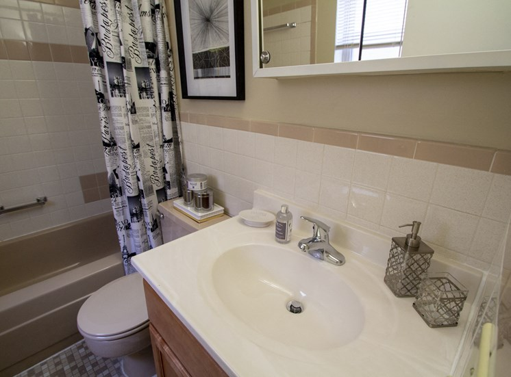 This is a photo of the bathroom of a 560 square foot, 1 bedroom apartment at Aspen Village Apartments in Cincinnati, OH.