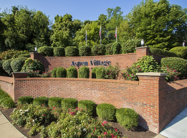 THis is a photo of the entrance sign at Aspen Village Apartments in Cincinnati, OH.